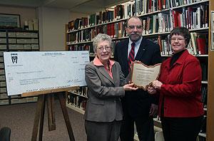 Bill Barrow receiving plaque