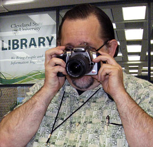 Student in Library with Camera
