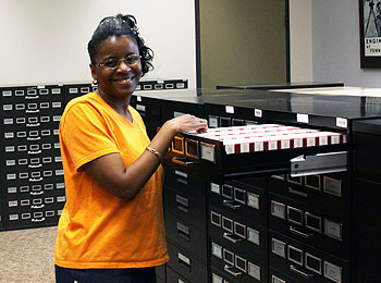 Library staff, Nedra Haymon, with microfilms